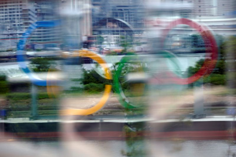 A giant Olympic Rings monument is seen through a glass at Odaiba Marine Park in Tokyo, Japan, 12 May 2021 (issued 13 May 2021).